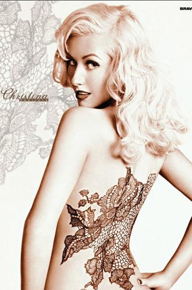 Christina Aguilera also jumped on the band-wagon of naked perfume endorsement for her self-titled perfume, however considering her 'Stripped' era we are not really surprised. Loving the faux tattoo!